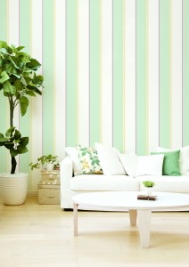 Living room with green and red stripe wallcovering
